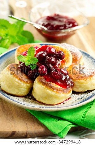 Breakfast with yeast pancakes and cranberry sauce