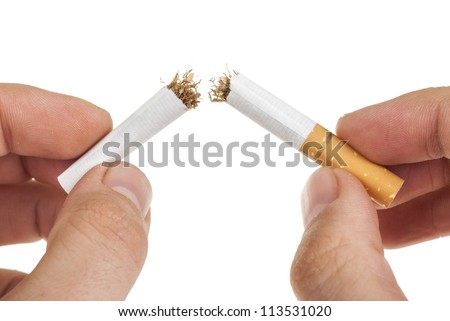 breaking a cigarette. Isolated on a white background - stock photo