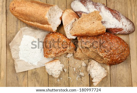Breaking bread on wooden table