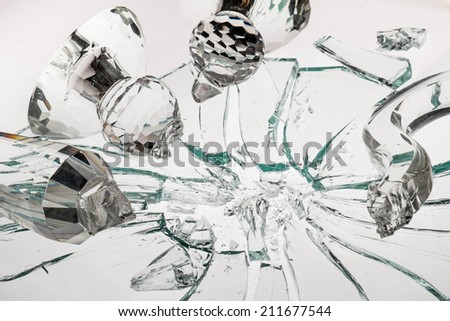 breaking crystal candle stand on broken glass - stock photo