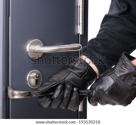 breaking into a steel door - stock photo