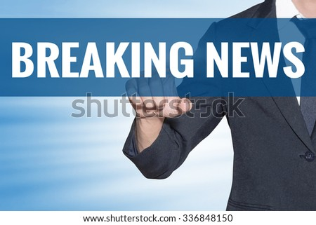 Breaking News word Business man touching on blue virtual screen - stock photo