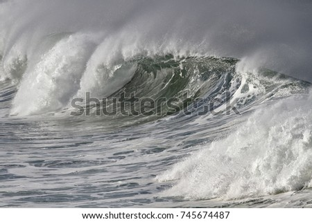 Breaking sea wave with wind spray. Northern portuguese coast.