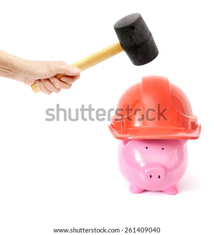 Breaking the Bank Piggy Bank on White Background with Safety Hat - stock photo
