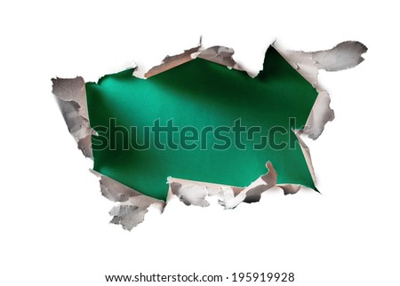 Breakthrough paper hole isolated on white. - stock photo