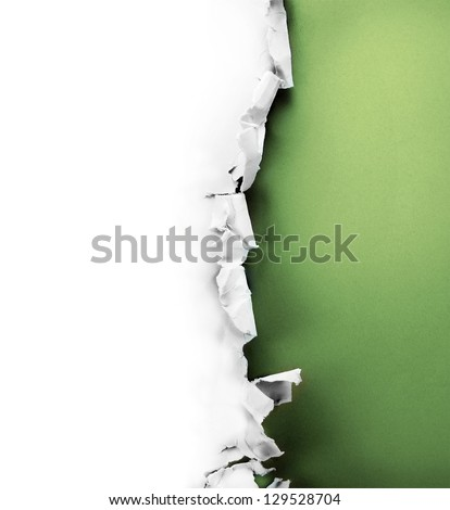 Breakthrough paper hole with green background inside, isolated on white. - stock photo