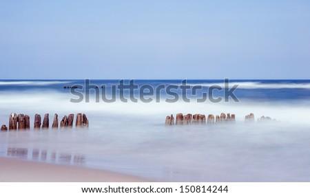breakwater and sea - stock photo