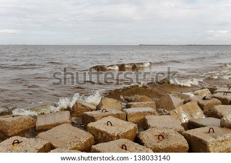 Breakwater at the Baltic sea shore. - stock photo