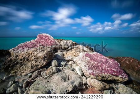 Breakwater in the Caribbean - stock photo