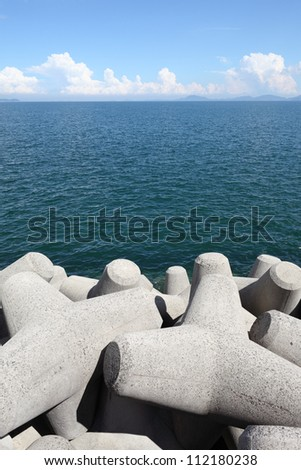 Breakwater with concrete blocks for protection of coast - stock photo