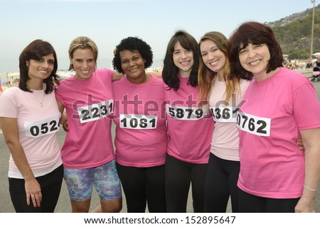 Breast cancer awareness charity race: Diverse group of women in pink