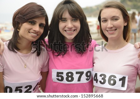 Breast cancer awareness charity race: Three women in pink - stock photo