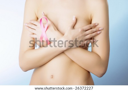 Breast cancer. Pink ribbon on a woman's breasts. Concept of medicine and health care