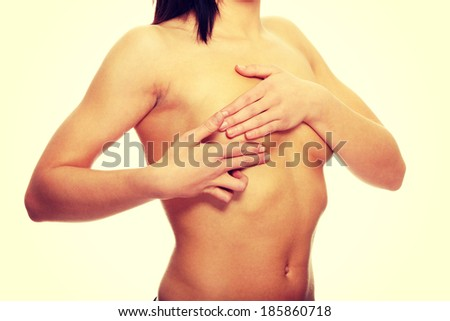 Breast cancer - Woman holding her breast