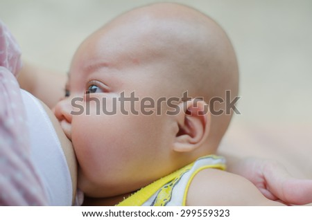 Breast feeding mother and baby