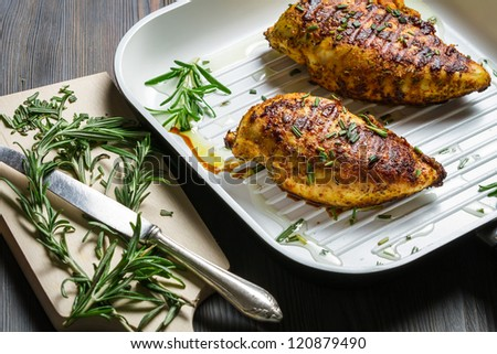 Breast of chicken fried with spices - stock photo
