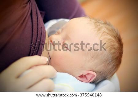 Breastfeeding of newborn - stock photo