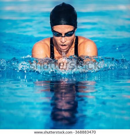 Breaststroke swimming woman - stock photo