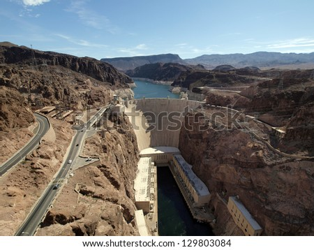 Breath taking Aerial view of the Colorado River, Hoover Dam, and road taken from bypass bridge on the border of Arizona and Nevada, USA. - stock photo