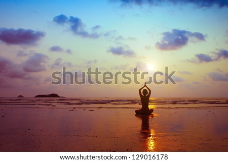breathing exercises, silhouette of woman practicing yoga - stock photo