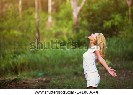 breathing exercises, woman enjoying the nature outdoors in the forest - stock photo