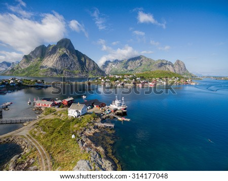Breathtaking aerial view of scenic town Reine and surrounding fjords on Lofoten islands in Norway, famous tourist destination - stock photo