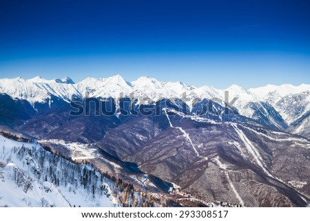 Breathtaking Caucasus mountains high view during winter time in Sochi ski resort Krasnaya polyana