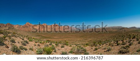 breathtaking panorama of red canyon with a blue sky Death Valley National Park