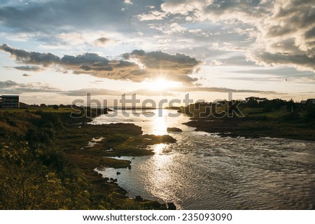 breathtaking scenery of a sunset and a sea shore - stock photo