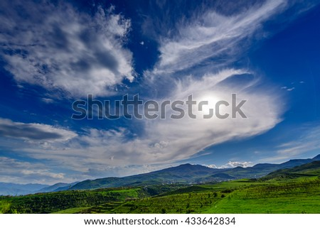 Breathtaking skyscape with beautiful clouds and the Sun, Armenia - stock photo