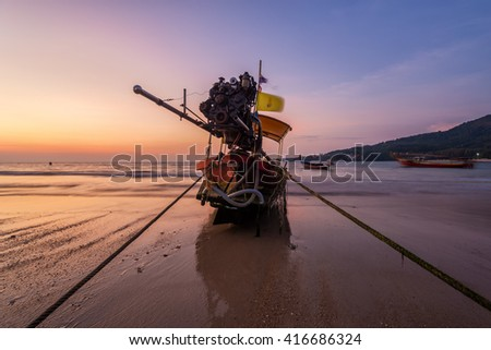 Breathtaking sunset during low tide at Kamala beach in Phuket Thailand - stock photo