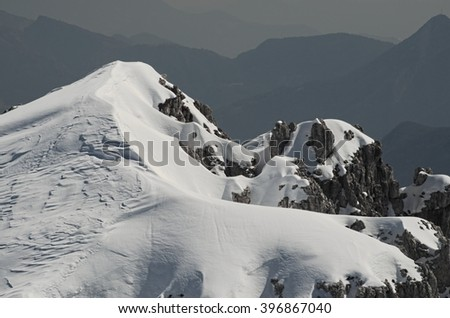 Breathtaking view of a high peak with rocks and snow. Rethian Alps, Lombardy, Italy.