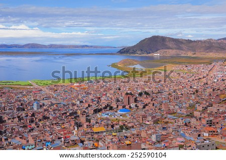 Breathtaking view of Puno by Titicaca lake. Peru. Lake Titicaca is the largest lake in South America and the highest navigable lake in the world. - stock photo