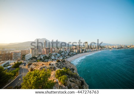 Breathtaking view of the coastline in Benidorm at sunset with high buildings, mountains and sea