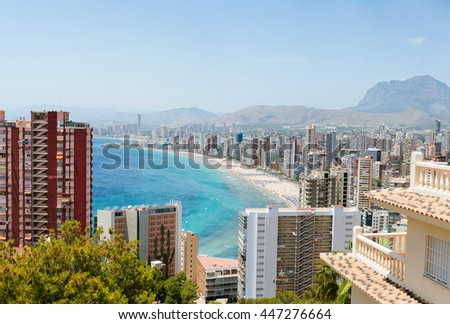 Breathtaking view of the coastline in Benidorm with high buildings, mountains and sea