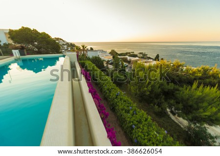Breathtakingly beautiful beachfront hotel with pool in Ibiza - stock photo