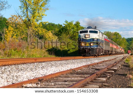 BRECKSVILLE, OH - SEPTEMBER 14: A passenger train on the Cuyahoga Valley Scenic Railroad passes through Brecksville Ohio on September 14 2013. The CVSR makes popular runs between Cleveland and Akron. - stock photo