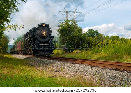 BRECKSVILLE, OH - SEPTEMBER 6, 2014: The NKP 765, one of the largest steam locomotives still in existence, draws close on the Cuyahoga Valley Scenic Railroad for the annual Steam in the Valley event. - stock photo