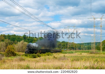 BRECKSVILLE, OH - SEPTEMBER 14, 2014: The NKP 765, one of the largest steam locomotives still in existence, pulls a passenger train through park land on the Cuyahoga Valley Scenic Railroad. - stock photo