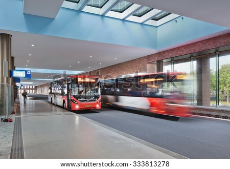 BREDA-HOLLAND-OCTOBER 10, 2015. Bus platform at the new constructed railway station Breda. The new platform provides space for twenty buses whose schedule will fit in well with those of the trains. - stock photo