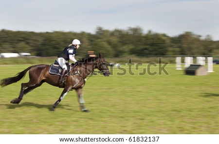 BREDA, HOLLAND - SEPT 5: Jockey on horse in gallop during yearly cross country contest at Breda Hippique on September 5, 2010 in Breda, Holland.