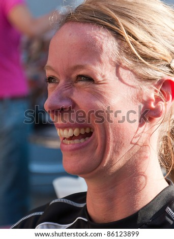 BREDA, NETHERLANDS – OCT. 2: Singelloop (Canal Run), Portrait of a female runner prior to the start of the yearly Singelloop in the Dutch city of Breda in the Netherlands on October 2, 2011.