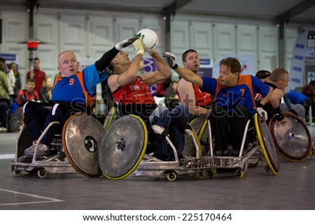 BREDA, NETHERLANDS - OCTOBER 12 : Dutch physically disabled athletes playing wheelchair rugby during the Paragames, a big bi-yearly event on OCTOBER 12, 2013 in BREDA, NETHERLANDS - stock photo