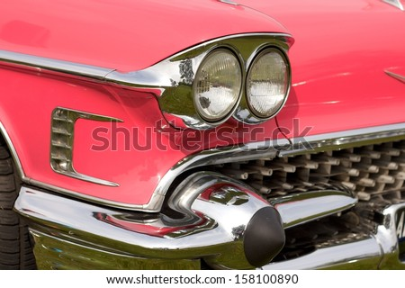 BREDA, NETHERLANDS - SEPTEMBER 02: Headlights of a Pink Cadillac at the Annual American Classic Car Show on September 02, 2012 in Breda, Netherlands - stock photo
