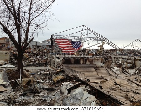 BREEZY POINT, QUEENS, NY-December 2, 2012: Photograph of wreckage and debris from homes destroyed by devastating fire during Hurricane Sandy. 111 homes were destroyed in the out-of-control blaze. - stock photo
