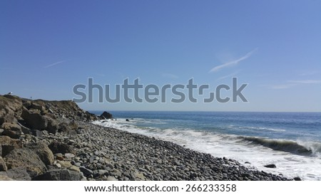 Breezy weather at rocky Thornhill Broom beach in La Jolla canyon, Ventura county, California - stock photo