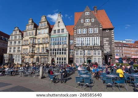 BREMEN, GERMANY - APR 5: People enjoying a sunny day in cafes in the old town of Bremen. April 5, 2014 in Bremen, Germany - stock photo