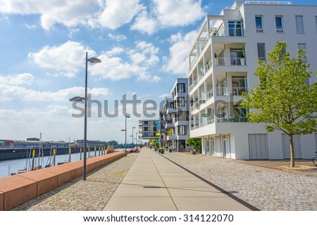 Bremen, Germany - June 6, 2014: Promenade of the Marina Europahafen Bremen, with modern buildings on the right - stock photo