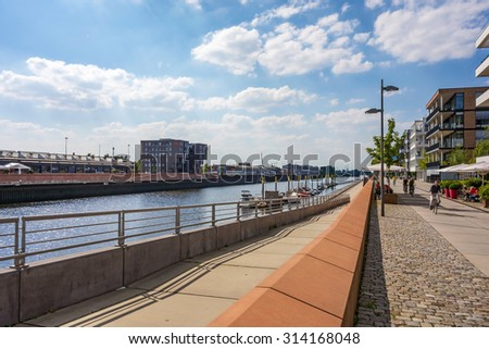 Bremen, Germany - June 6, 2014: View of Marina Europahafen Bremen promenade, a yacht facility in the heart of Bremen with no popple and stream - stock photo