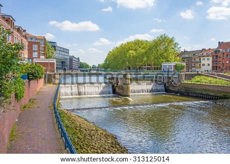 Bremen, Germany - June 6, 2014: View of the Kleine Weser river with weir, an anabranch of the Weser river - stock photo